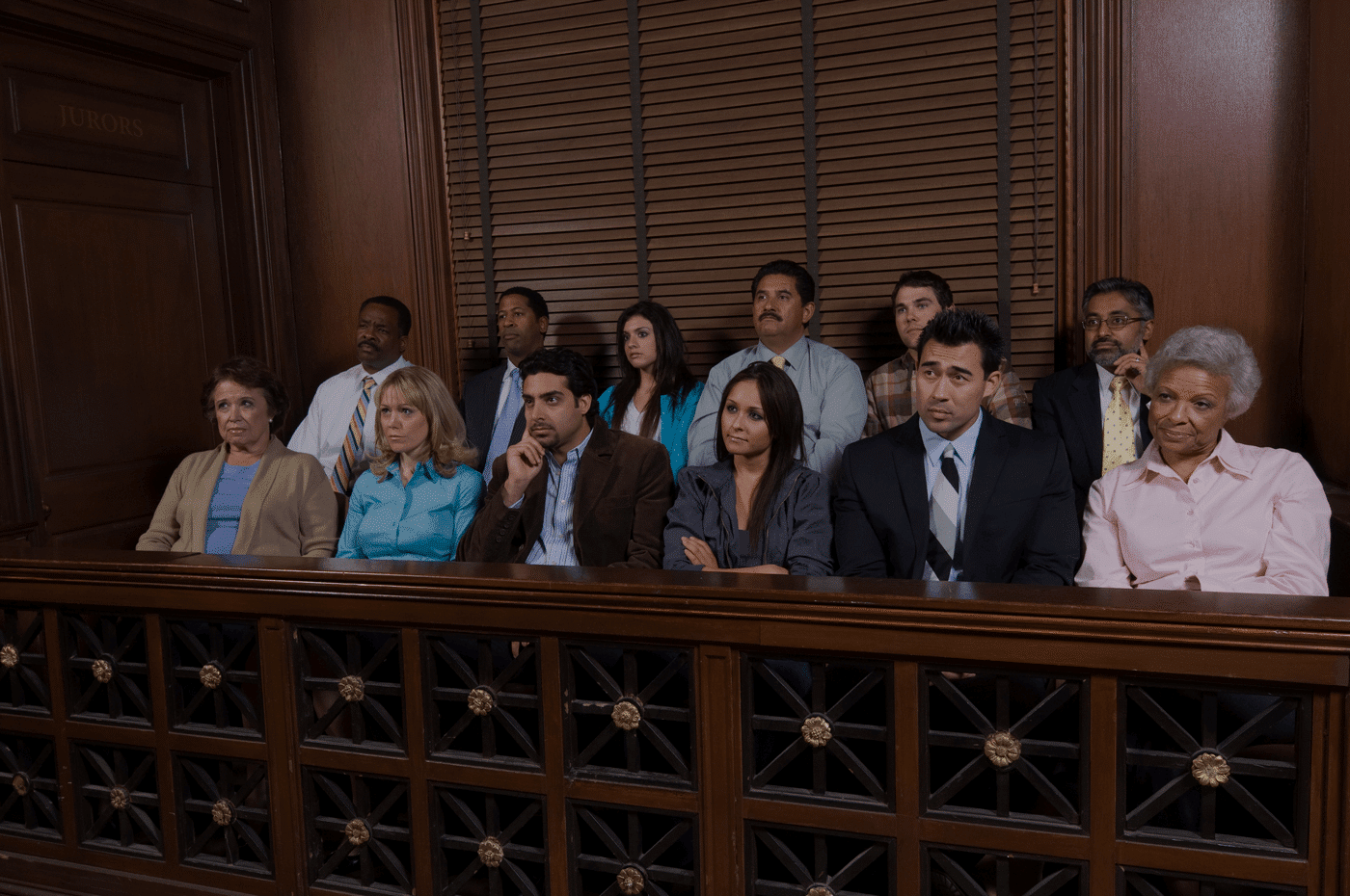 Court room jury box filled with jurors of a diverse mix